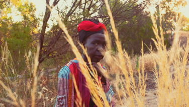 Feature image of South Sudanese musician, Ajak Kwai